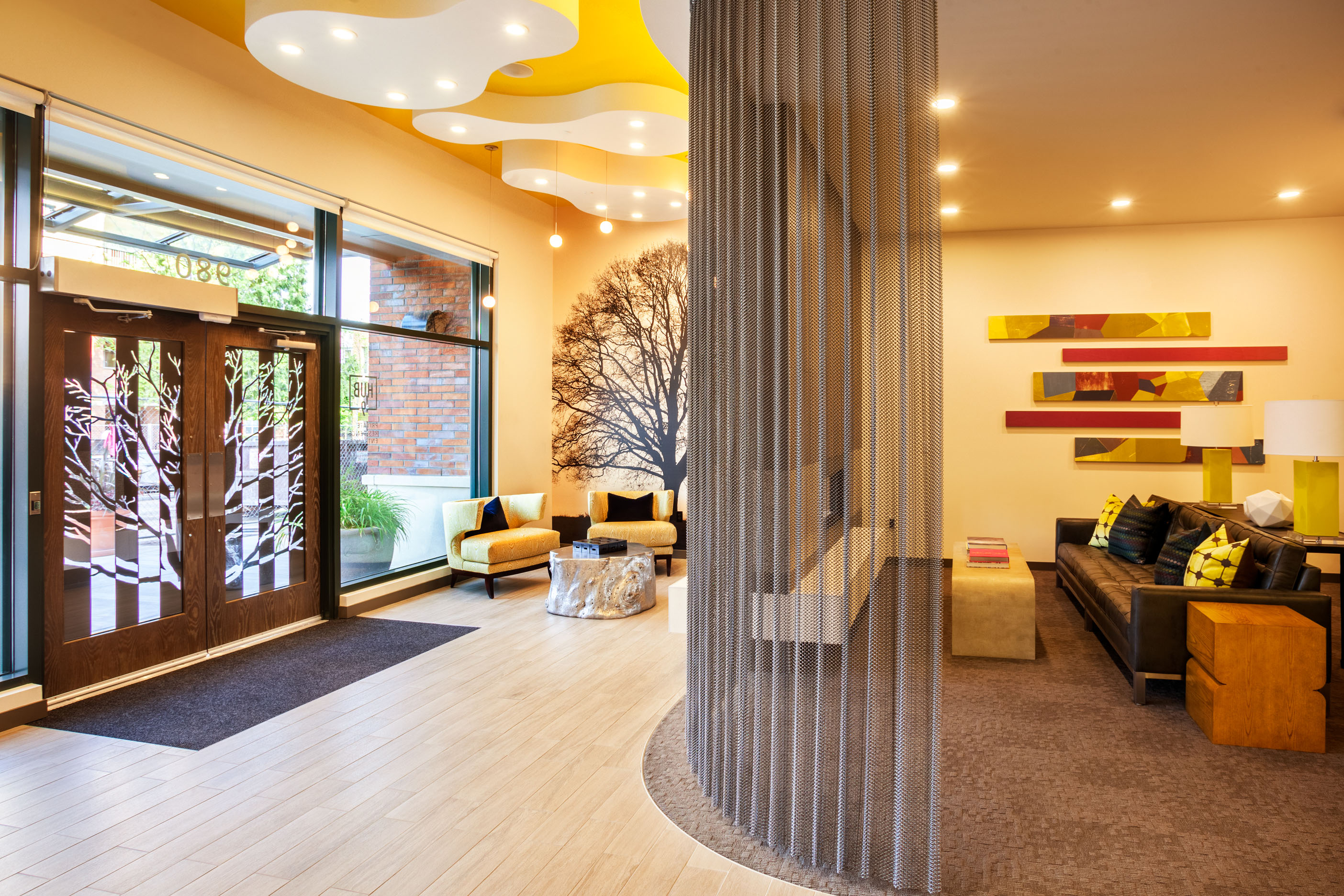 Pdx interior design brick front entry into building a radiant welcoming lobby of yellows