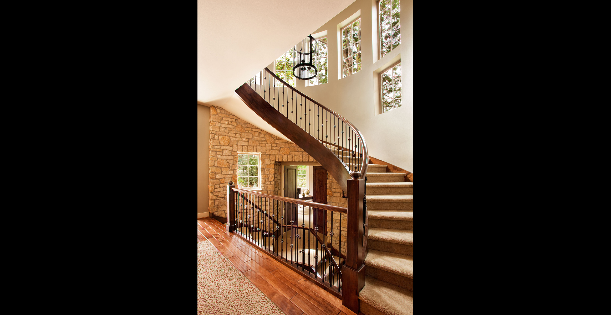 Handscraped floors and fieldstone highlight the entry into this home