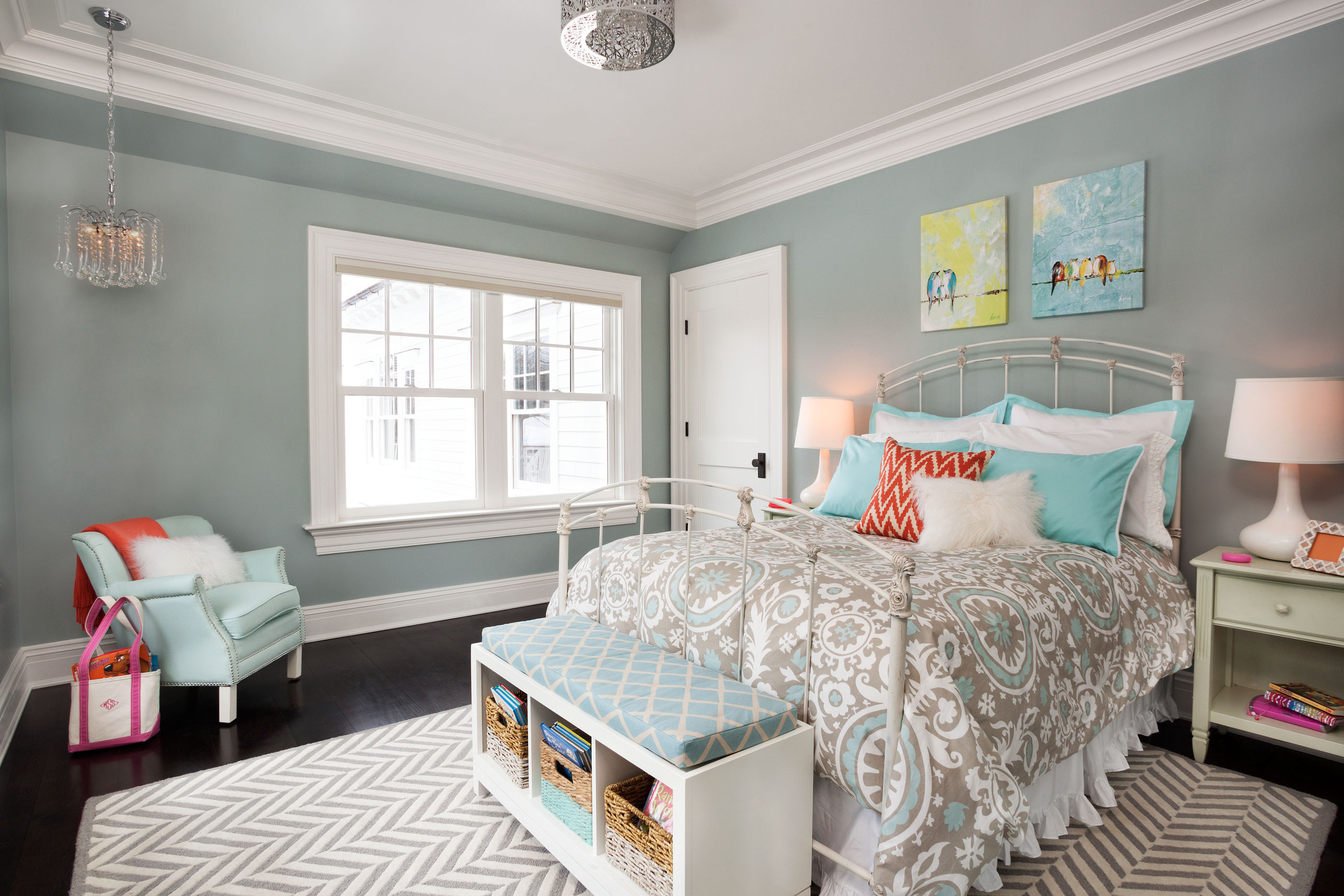 Beautifuly designed bedroom with blue patterns carpet windows