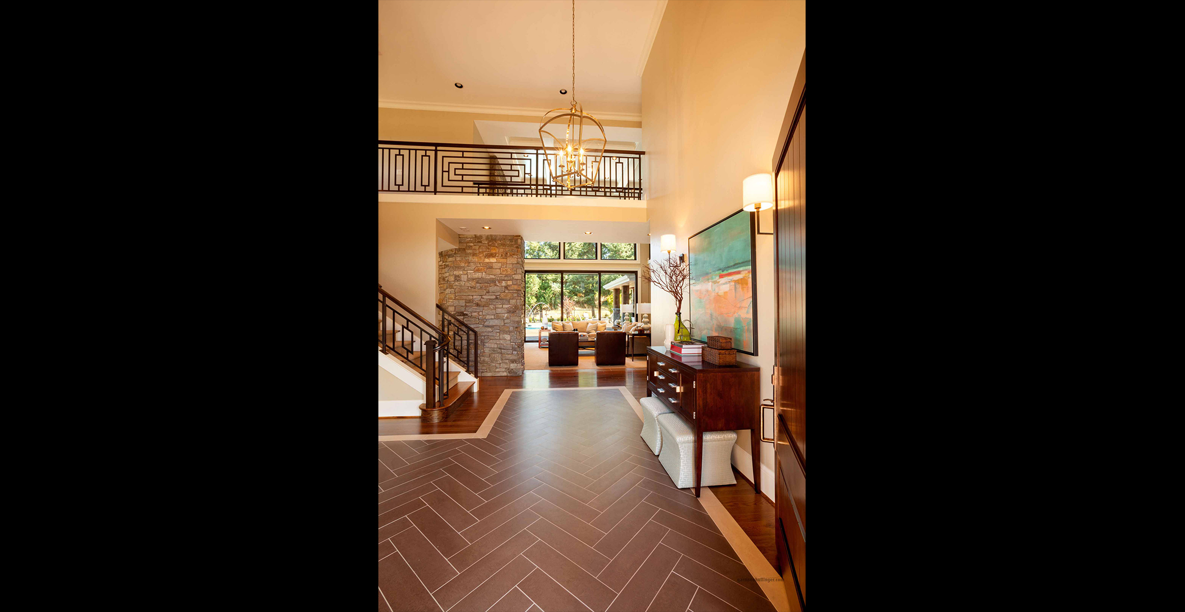 The homes entrance leads you into the warmth of the living area design