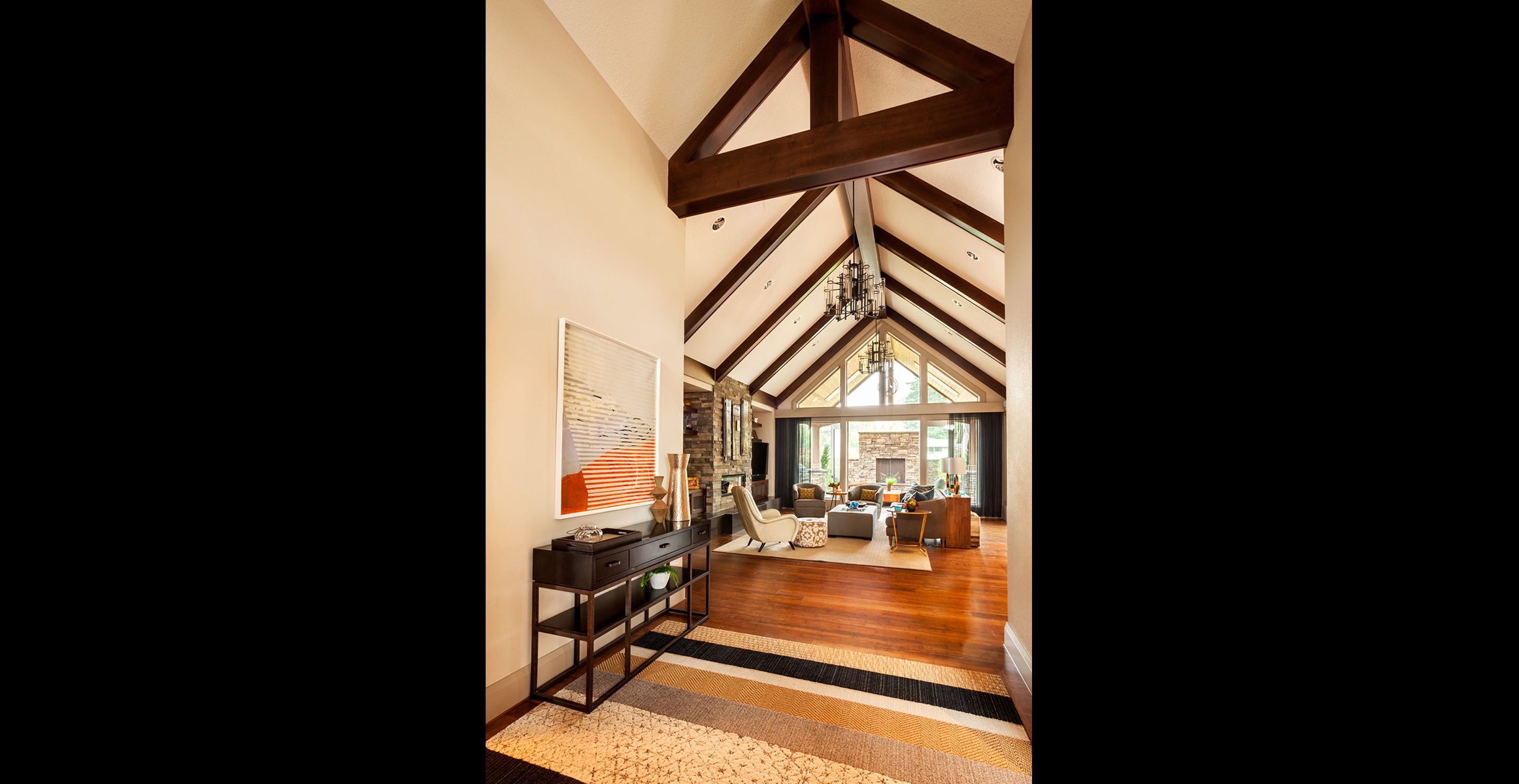 Large wooden beams are the focus of this high ceiling entry hall